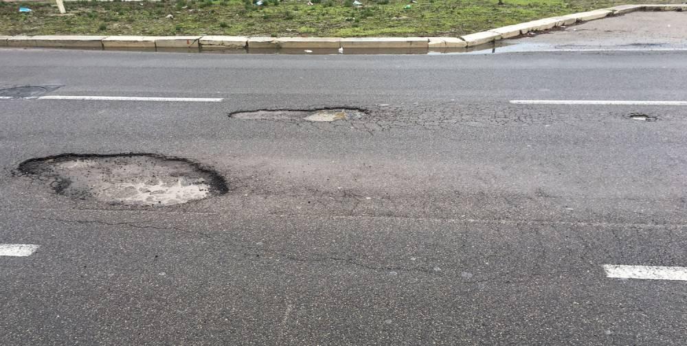 Come coprire le buche nell'asfalto